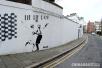 英国艺术家创作涂鸦《谎言之城》主角变成美英领导人