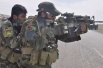 美耗资千万为阿富汗购迷彩服 只为讨阿前防长欢心