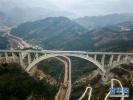 """世界首例""""贯入式大体积嵌岩拱座基础""""大桥建成投用"""