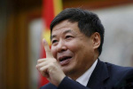 中国是否会抛售美债或者让人民币贬值? 朱光耀这样回应