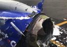 乘客从客机飞出致死