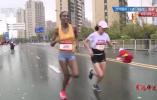 """苏州马拉松两个递国旗的志愿者,为何成了运动员夺冠的""""坎""""?"""