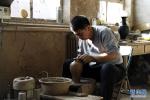 黑陶世界的彩艺人生